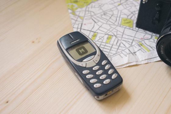 Nokia 3310 On A Wooden Desk